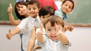 Happy children giving the thumbs up signal.